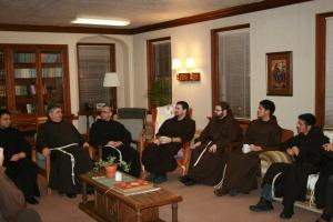 General Minister Fr.  Jose (second from left) meets with novices during his visit to the Franciscan Interprovincial Novitiate in Burlington, Wis.