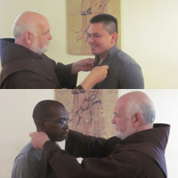 Postulants Wilmer Garcia (at top) and Junior Joseph (at bottom) receive the Tau cross from assistant postulant dorector Br. Bill Herbst, OFM, at St. Paul Friary in Wilmington, Del.