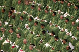 Male Seminarians in Green and While Robes