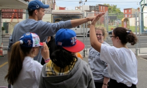 Francis Volunteer Ministers give a high five to a group of young adults.
