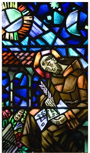 This stained glass depiction of St. Francis composing the Canticle appears in the windows of the chapel of St. Francis Friary in Manhattan.
